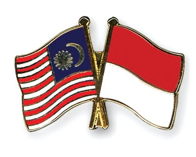 http://www.bloggerborneo.com/wp-content/uploads/2010/09/Flag-Pins-Malaysia-Indonesia.jpg